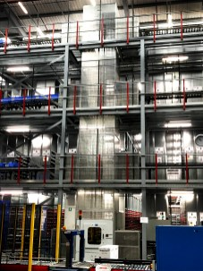 Single Carriage Reciprocating Hoist services 3 floors in a Distribution Centre