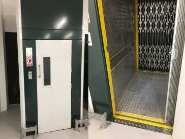 All NERAK Machines can be branded to suit your company colours. This John Lewis Cage Lift moves cages between floors