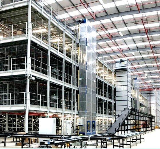 Infeed conveyors leading to overhead conveyors servicing a Mezzanine via 3 NERAK Lifts