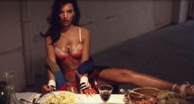 Emily Ratajkowski strips to lacy underwear and rolls around in spaghetti for Love Magazine's Advent Calendar