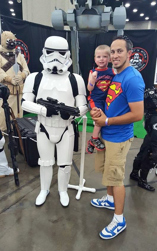 man and his son with professional Star Wars cosplayers the 501st Legion