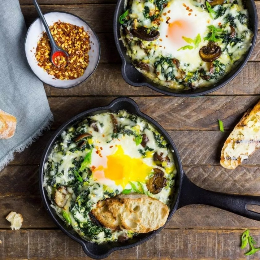 Baked Eggs with Creamy Greens and Garlic Butter Toasts