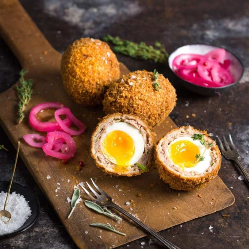 A platter of Scotch Eggs with runny Yolks