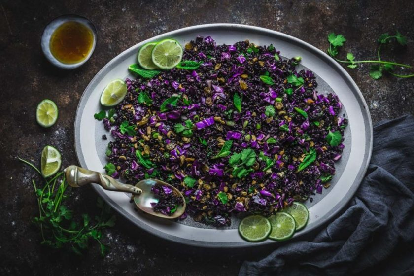 A platter of black rice sprinkled with herbs