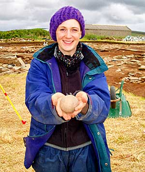 Kim with her star find, the stone ball.