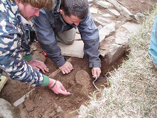 Hugo and Stacey excavating the complete pot in Structure 14.