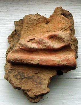 The latest coloured pot sherd.