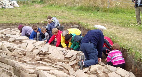 Heads down there must be something interesting here! — budding archaeologists at the Excavation Club.