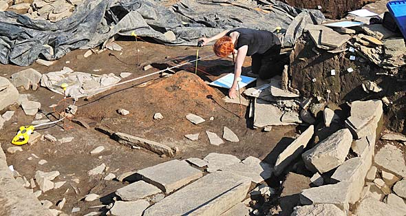 Joanne finishes recording the burnt mound in Structure Eight before it is sampled for archaeomagnetic dating.
