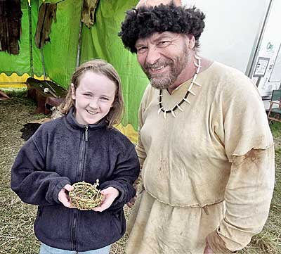 Tony Sherratt with another satisfied trainee Neolithicist, Beth, with her grass basket.
