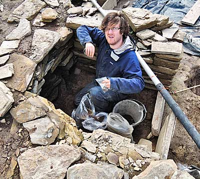 Neil reveals a drain in the north-east cell of Structure One.