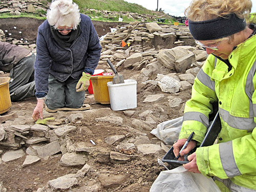 Anne and Christine start to reveal the cattle teeth in the new southern entrance to Structure Eight.