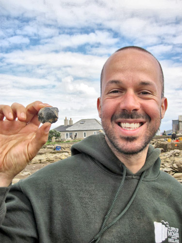 Andrea is pleased with his discovery of the large piece of pitchstone found so far at the Ness.