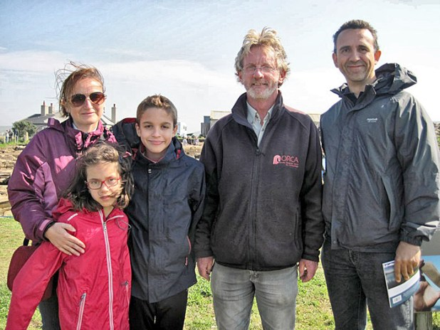 The one-thousandth visitors at today's open day — the Pinon family, from Spain, who were presented with a signed copy of the new Ness guidebook by director Nick.