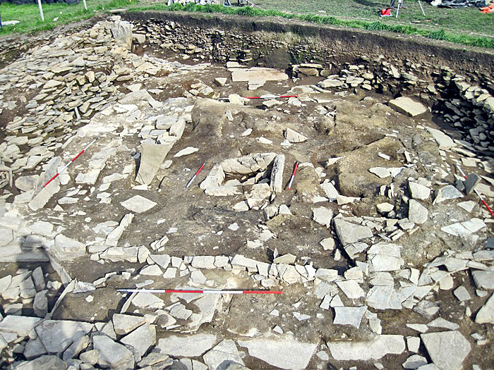 The freshly cleaned central chamber of Structure Ten. Note the massive threshold stone on the far side of the photo.