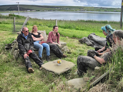 A well-earned rest on the stone furniture constructed and frequented by the Structure Twelve team.