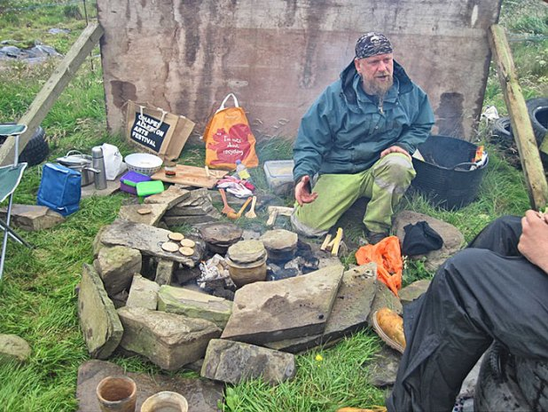 Mike cooks up a Stone Age meal in his replica Neolithic ceramics.