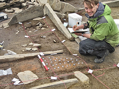Sam already hard at work taking 'button' samples from a hearth in Structure Eight.