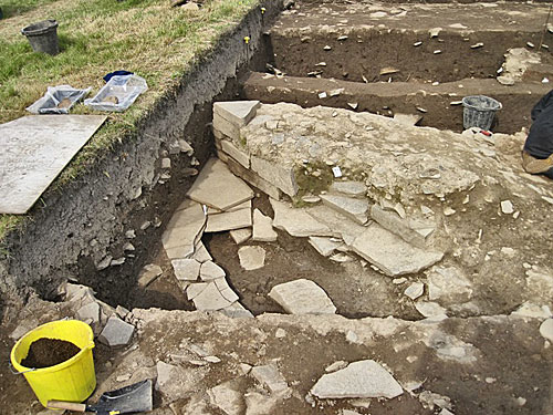 The three layers of flagstone paving covering the drain on the outside of Structure Twenty-Seven in Trench T.