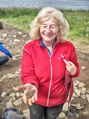 "Another find from Trench X - Molly is pictured with her shaped-stone ""thing""."