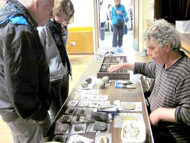 Mark Edmonds discussing the joys of some of the fine stone tools with visitors to our outreach at the Stenness School.