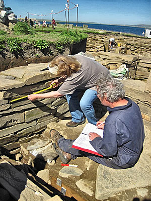Martha and Mark recording the stone in the inner wall face of Structure Twelve.