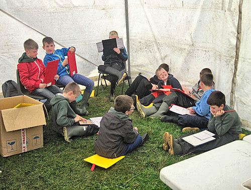 Some of the Glaitness Primary School pupils writing about their first visit to the Ness.