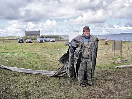 Chloë making use of every last scrap of tarp.