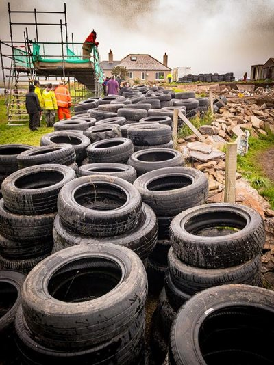 The tyres relocated to the side of Trench P last year, ready to be put in place. Hard work, but rewarding.