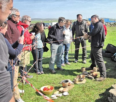 Mike Copper shows some of his superb replica Neolithic pottery at one of the site open days.