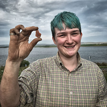 Emma with the flint tool she found in Structure Eight today.