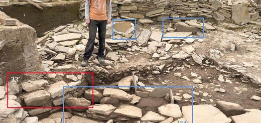 Travis studies the uncovered remains of two 'new' buildings - Structure Thirty-Three (highlighted in red) and Thirty-Four (in blue).
