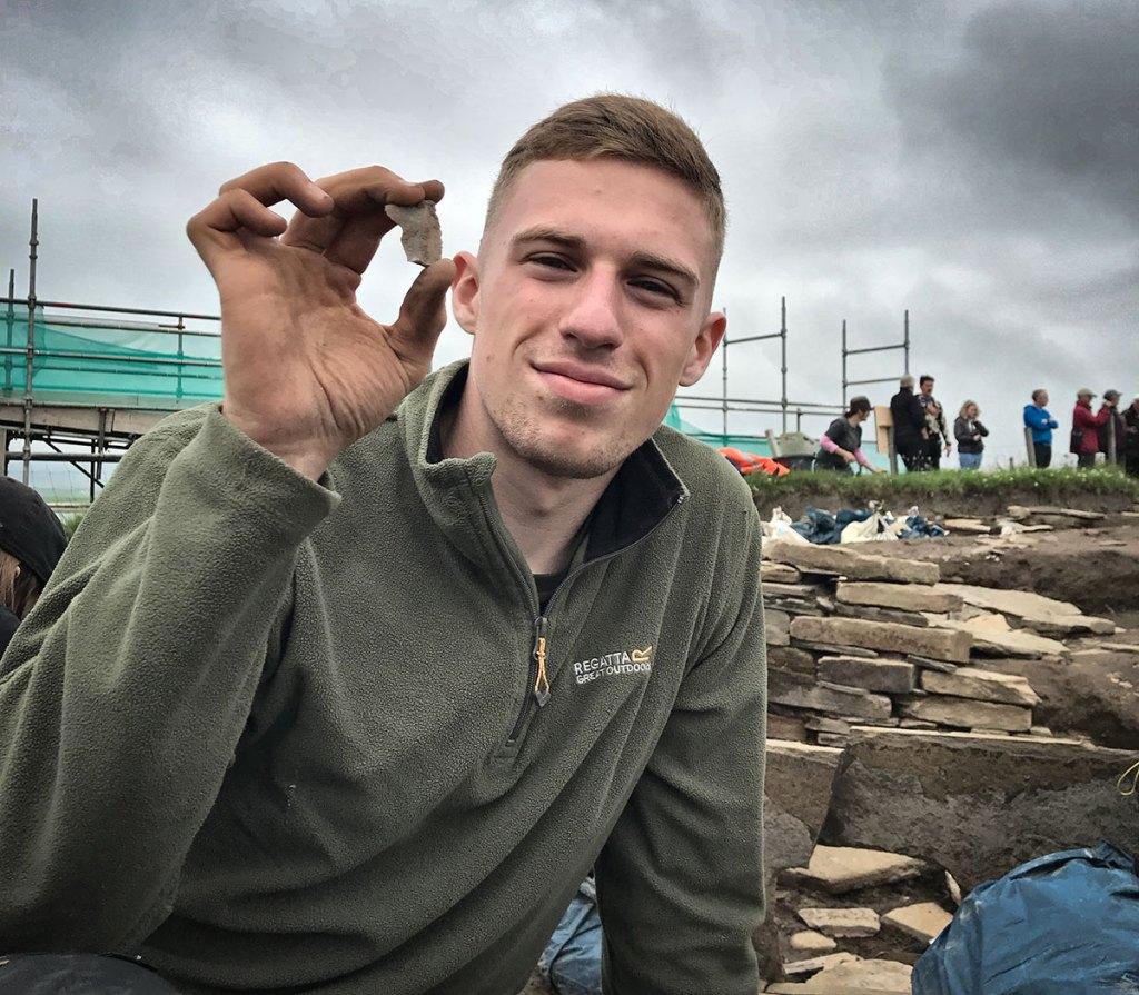 Declan with flint found in Structure Eight.