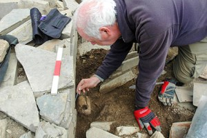 Roy excavating the whalebone macehead from Structure Eight. (ORCA)