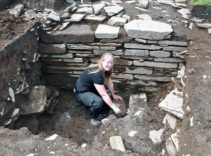 Sarah excavating at the bottom of the 'Lesser Wall of Brodgar' in Trench R in 2010. (ORCA)