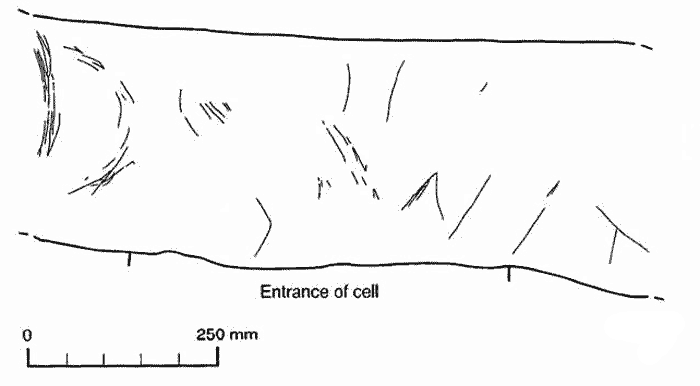 Incised motifs above a cell entrance within the Cuween cairn.
