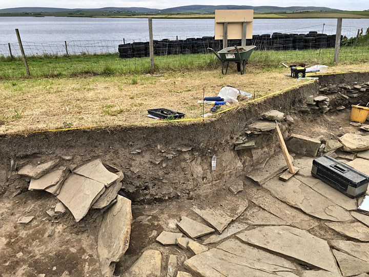 The suspected entrance to Structure Ten's outer passageway, flanked by two upright stones. The paving around the building runs under the trench section. (Sigurd Towrie)