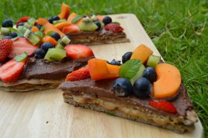 healthy dessert pizza with caramel oozing out for World chocolate day
