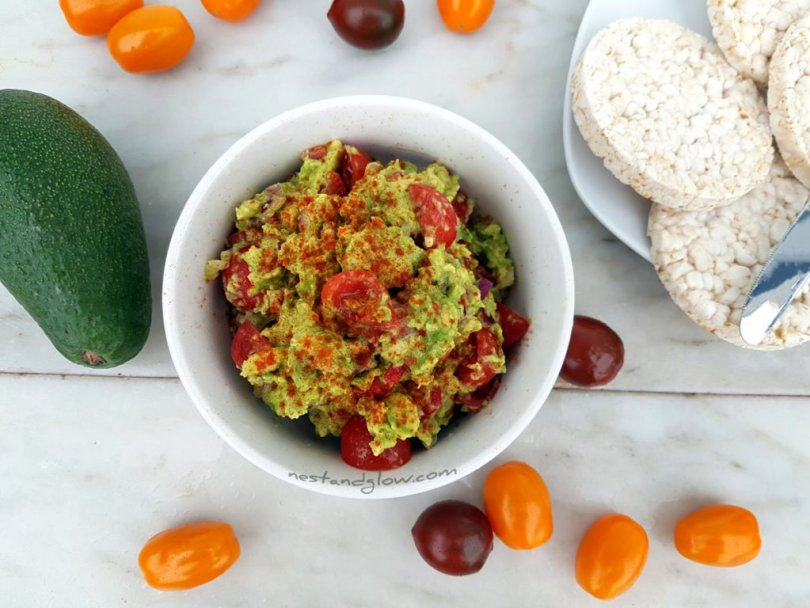 Easy delicious guacamole with black and yellow tomatoes