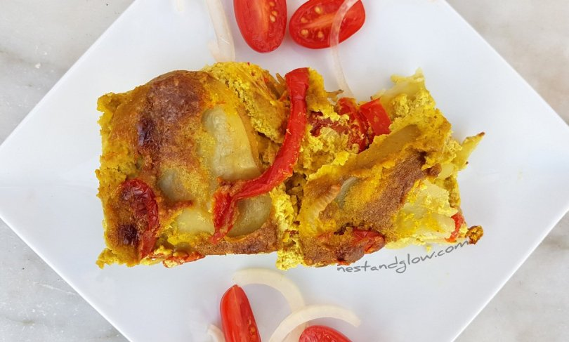 A slice of vegan cheese and tomato potato bake