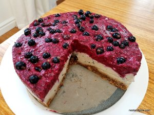 A large Blackcurrant Cashew Vegan Cheesecake