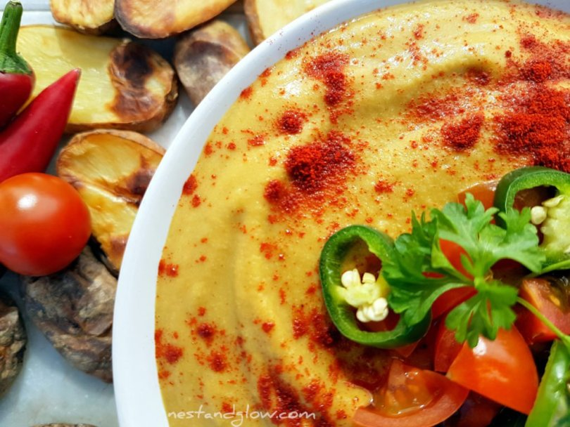 Light Queso Cheese Dip topped with paprika, chilli and tomatoes