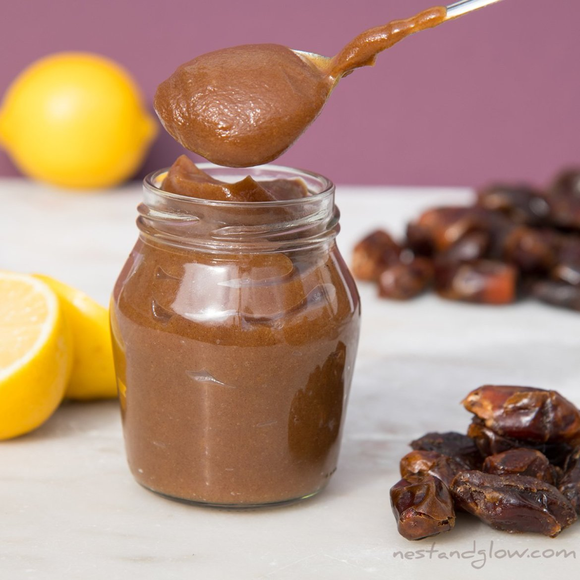 natural sweetener date syrup on a spoon