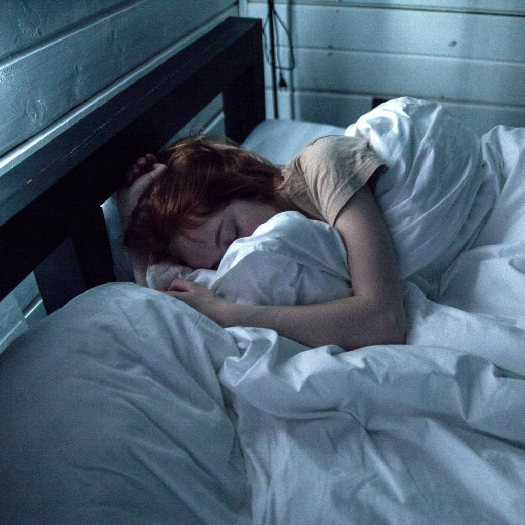 adult sleeping badly in bed