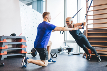 Male Personal Trainer working with woman