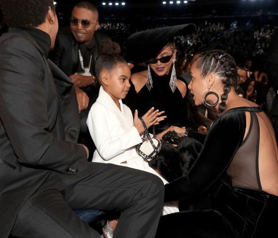 Blue Ivy rocks $2,675 Valentino Rockstud Clutch to 2018 Grammys