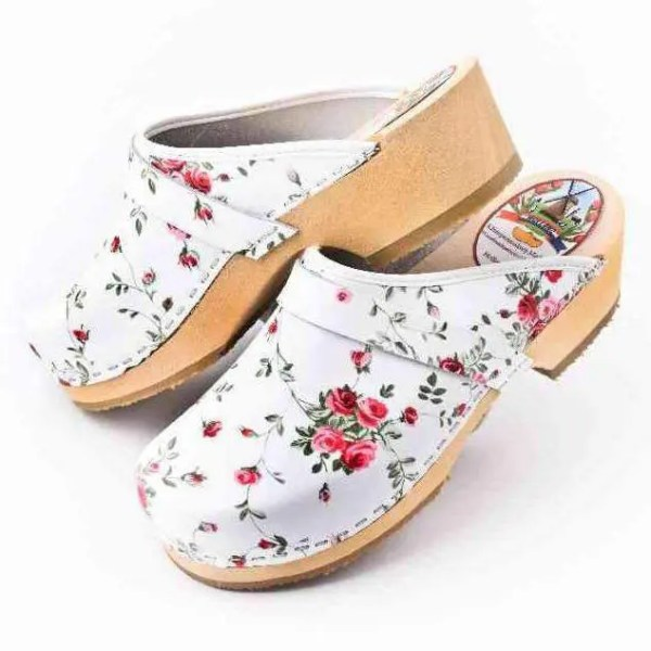 white clogs with flowers