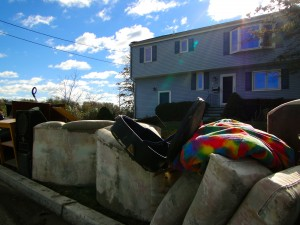 Flood-damaged furniture piling up in front of Patriuce Devincentis' house.