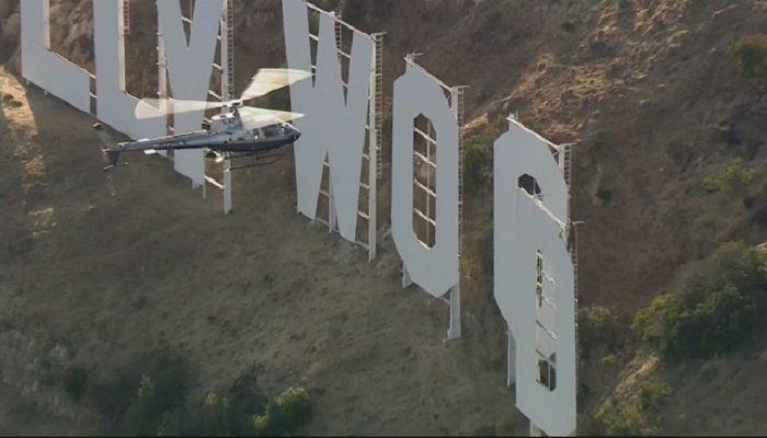 YouTuber on Hollywood sign followed by helicopters-Netmarkers