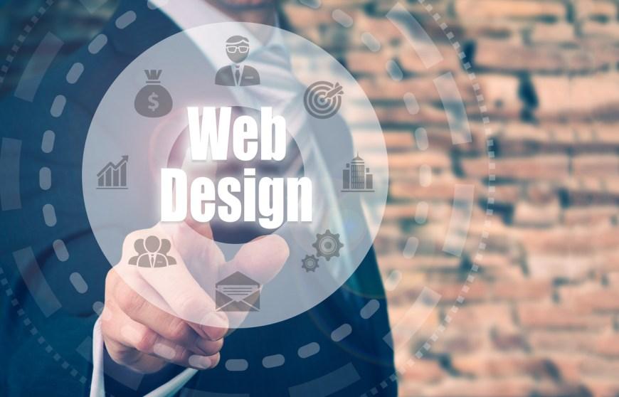 Businessman selecting a Web Design Concept button